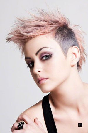 woman very short hairstyle pink and black hair