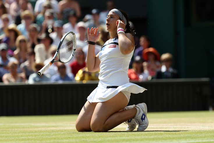 Marion Bartoli collapses after her win in the Ladies' final. - Steve Wake/AELTC