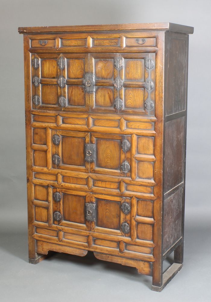 """Lot 916, A Chinese hardwood cabinet of panelled construction fitted 2 short drawers above 3 cupboards enclosed by double panelled doors, 65""""h x 42""""w x 18""""d, est £260-360"""