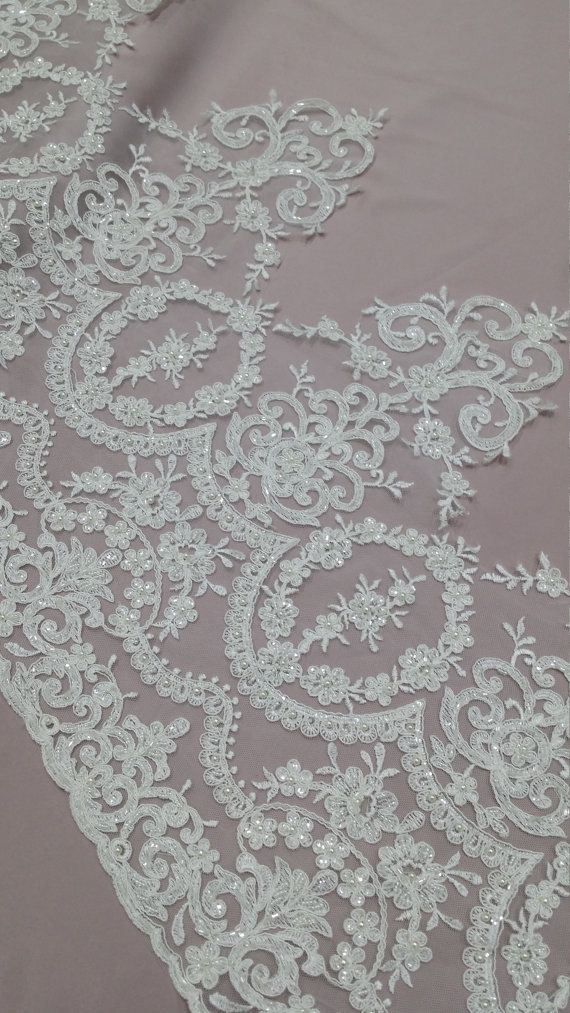 Ivory color beaded lace trimming. Both sides scalloped. Width: 42 cm/16.5 inches Item number: EVSL015CB Price is set for one meter/yard. You will receive the fabric in one continuous piece if you purchase more than 1 meter/yard. You can purchase a sample here: