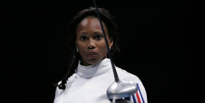 JO - Londres 2012 : Flessel porte-drapeau  Laura Flessel-Colovic a été désignée lundi porte-drapeau de la délégation française pour les Jeux Olympiques de Londres. Elle est la troisième femme - après Christine Caron et Marie-José Pérec - à décrocher ce titre honorifique.