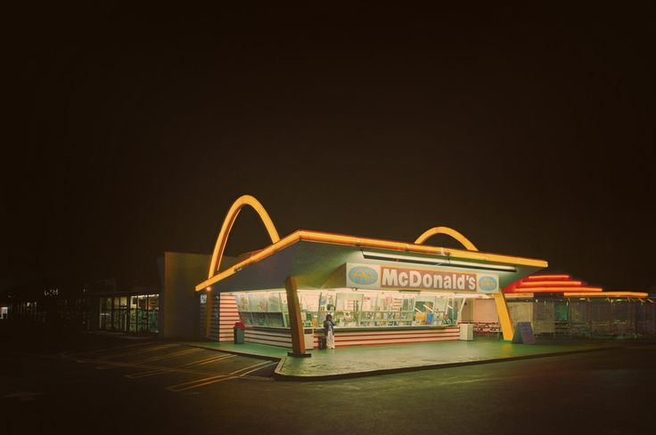 """The oldest operating McDonald's restaurant is a drive-up hamburger stand at 10207 Lakewood Blvd.  in Downey, California. It was the 3rd McDonald's restaurant, and opened in 1953. It was the second restaurant franchised by Richard and Maurice McDonald, prior to the involvement of Ray Kroc in the company, and it still has the two original 30-ft """"Golden Arches"""" & a 60-ft animated neon """"Speedee"""" sign that was added in 1959."""