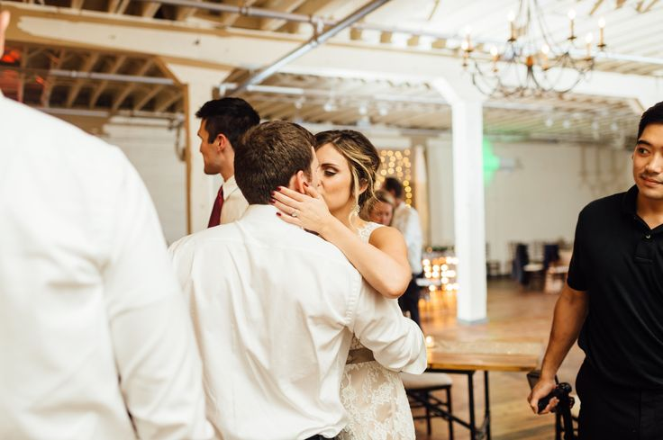 BRIK Venue | Fort Worth | Texas | Industrial | Warehouse | Weddings | Wood Floors | White Painted Brick | Anna Smith Photography | Bride and Groom | Wedding Dress | Lace Dress | Grey Suit | Reception