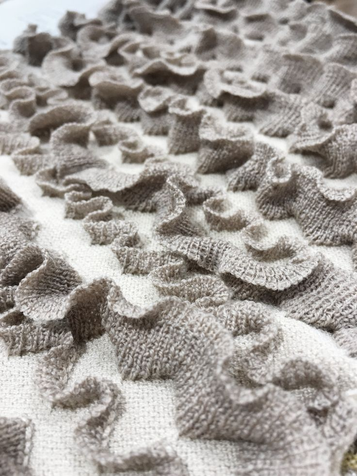 knit ruffles- SHANGHAI SPINEXPO 2017 SPRING SUMMER #spinexpo #spinexpo2017 #yarndesign #fabricdesign #knitwear #knitweardesign #knitdesign #fashiondesign #knitfashion #yarn #fabric #pattern #patterndesign #knitwearpattern #stitches #knitstitches #sweaterdesign #sweaterpattern #sweaterfashion #yarns #pointelle #texture #texturedesign #fashiontexture #knittexture #knitting #fashiondetails #fashiondetail #knitdetails #fabrics