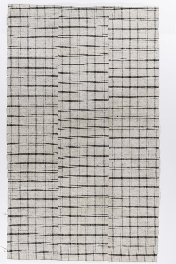 Black and White Tartan Kilim. Made from Cotton and available with backing, beautiful design for an array of settings.