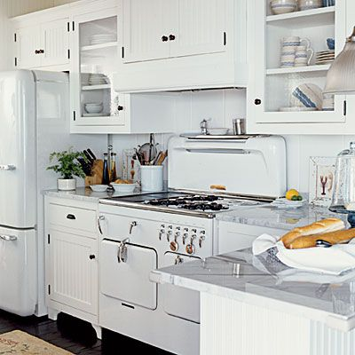 Install white beaded board and retro appliances to create classic cottage style in the kitchen. | Coastalliving.com