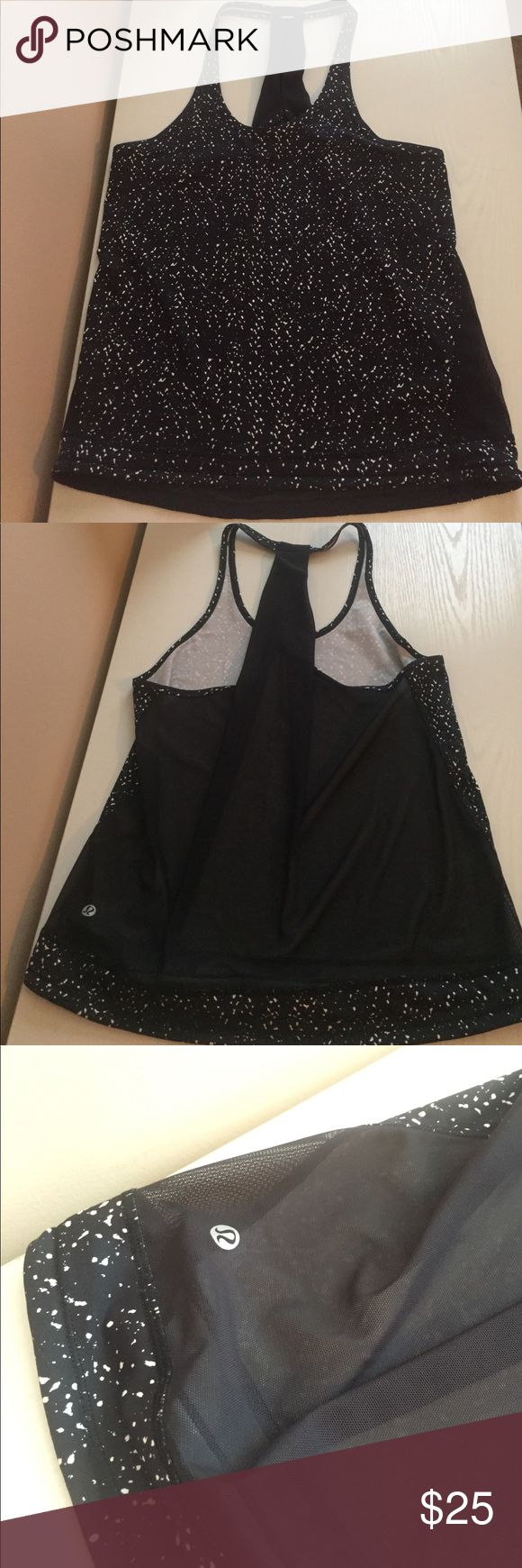 Lululemon Mesh-back Tank Lululemon black and white speckled mesh-back tank top! Size 4/6. This top is SO CUTE! I really wish it fit me because the mesh back is so pretty. Re-poshing because it's a little to big for me. I wear a 4 in lulu sports bras and a 2/4 in tops depending. This top has a string to tighten the bottom if it's too wide. lululemon athletica Tops Tank Tops