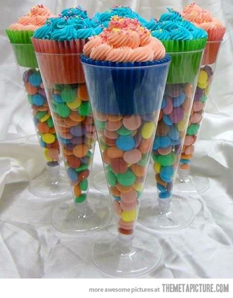 Cupcakes in champagne flutes (from Dollar Store) for various events. Fill 3/4 of the way with M's or other colorful small round candies...and put cupcake on top so that just the frosting is exposed at the top of the flute.