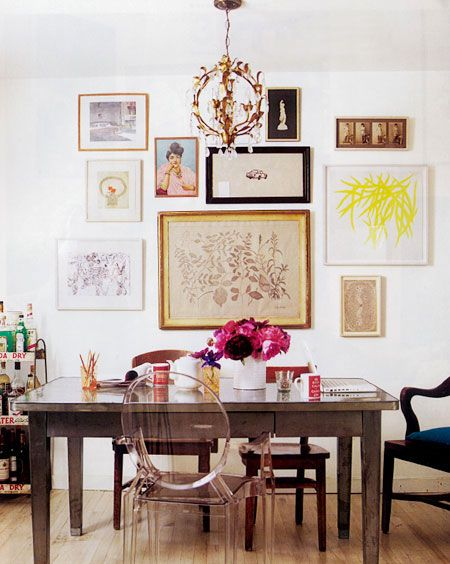 have always loved this pic, was on my pre-pinterest (real, collaged) mood board for my living room. love the table with mixed chairs. some day i will have a lucite chair.