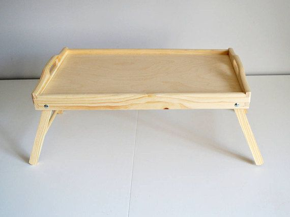 """Large Breakfast Tray-Bed Tray-Tray with Legs-Serving Tray-Unfinished Tray-Decorative Wooden Tray-Pine Tree trays-Untreated Wood Tray  A pine tree tray!  This breakfast tray is a large untreated wood tray !  This large breakfast tray in bed tray contains folding legs.   Ready to use as it is or can be transform into your own creation!  Can be painted, treated with varnish, engraved or use for decoupage!   Dimensions : 19.6"""" or 50 cm long , 11.8"""" or 30 cm deep , and 10.6"""" or 27 cm tall."""