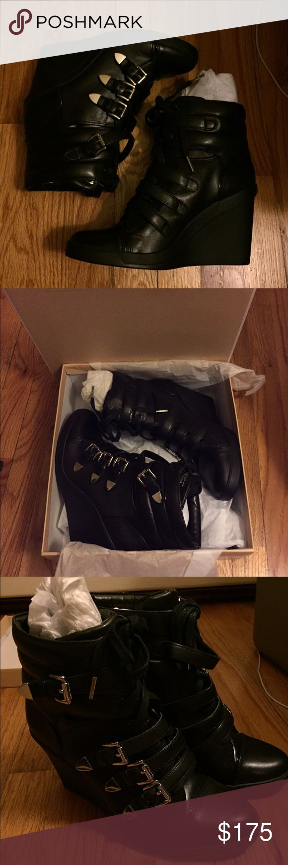 New In BOX Michael Kors Black Wedge Sneakers 10 Brand new in box with all original packaging. Michael Kors Black wedge sneakers. Style is Robin. Size 10. Purchased at the Michael Kors in the mall near me for full price. Price is absolutely firm!!! Michael Kors Shoes Wedges