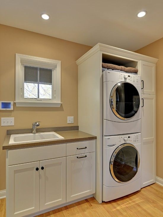 Awesome laundry room ideas stacked washer dryer design with white washing machine and wooden for Washer and dryer in bathroom designs
