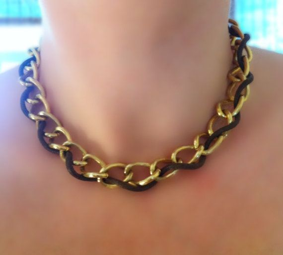 Chunky brass choker accented with chocolate brown leather. Uptown chic.