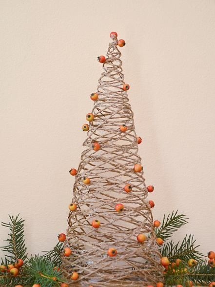 Dress up your mini holiday tree with upcycled decor and materials from around the house.