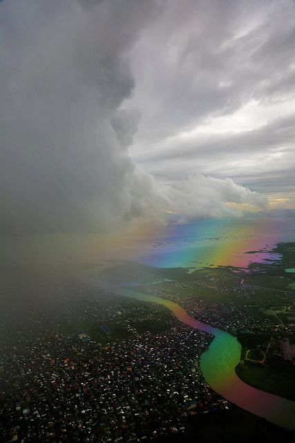 Storm Cloud Edge photo by Bernie Ledesma (note the rainbow just ahead of the cloud... or just behind it)