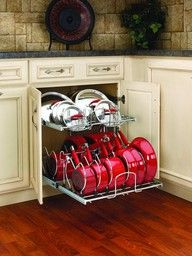 This is a smart one: Use old dishwasher racks for storage of pots and pans.