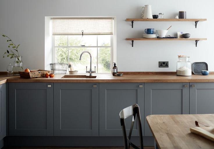 A dark grey Shaker style kitchen cabinet door with a wood grained detail complimented perfectly by our Solid Oak Block worktop. This is the Fairford Slate Grey Kitchen Range from Howdens.
