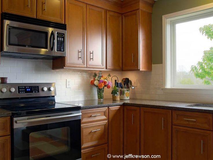 black quartz countertops white subway tile backsplash ... on Backsplash With Maple Cabinets  id=32459
