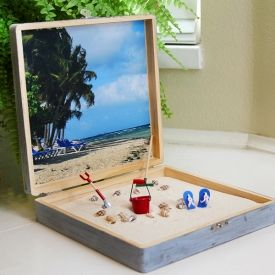 Preserve a little summer vacation by making your own Beach in a Box! Perfect to liven up a cubicle. Full photo step-by-step tutorial. Use kinetic sand!
