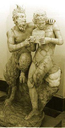 Pan teaching his eromenos, the shepherd Daphnis, to play the pipes, 2nd century AD Roman copy of Greek original ca. 100 BC, found in Pompeii.