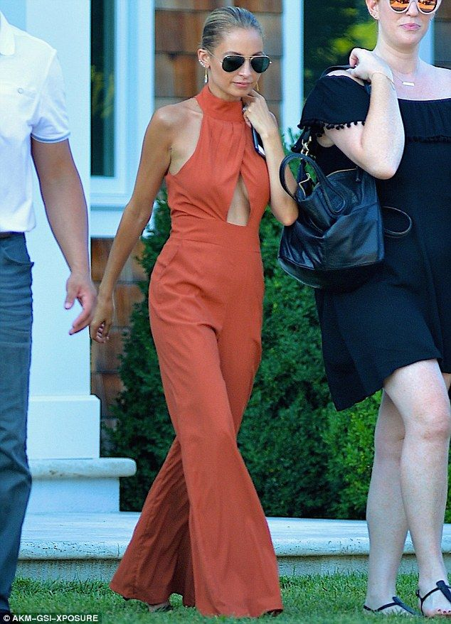 New look: In the 12 September issue of People, Nicole Richie expressed a penchant for bodysuits and said she 'can't just go out and wear some miniskirt,' because she is only 5'1' (seen here in July)