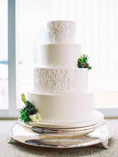 White lace covered wedding cake: http://www.stylemepretty.com/little-black-book-blog/2014/12/19/whimsical-elegant-charlotte-wedding/   Photography: Lauren Rosenau - http://www.laurenrosenauphotography.com/