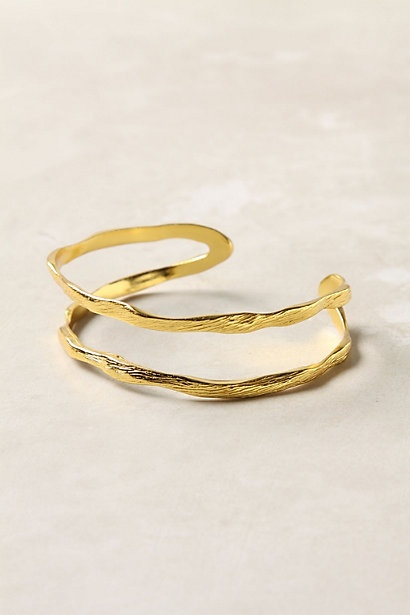 powerful gold bracelet from Anthropologie // i like forms that reveal detail
