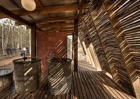 This bathhouse in Thailand features an angled bamboo facade that provides shelter from the tropical sun