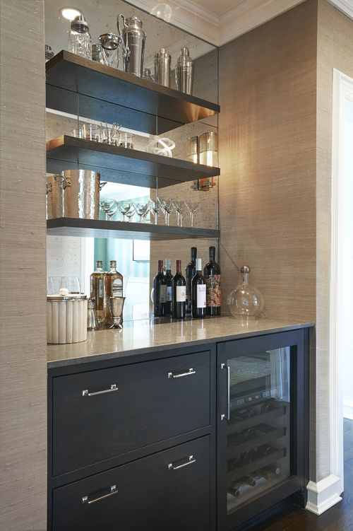 Chic Butlers Pantry Boasts A Nook Filled With Grey Cabinets Fitted Glass Front Beverage Fridge Placed Under Floating Shelves Lining Mirrored