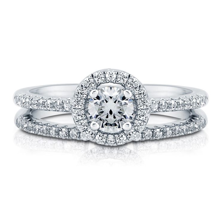 I'm in love with this.....  One of my 3 dream rings!  Sterling Silver with Round Swarovski Zirconia Halo Ring Set 0.74 ct.tw