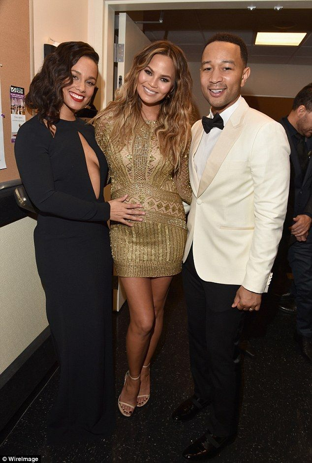 Bump love! Alicia Keys patted Chrissy Teigen's pregnancy bump as they posed with John Legend atSinatra 100: An All-Star GRAMMY Concert in Las Vegas on Wednesday