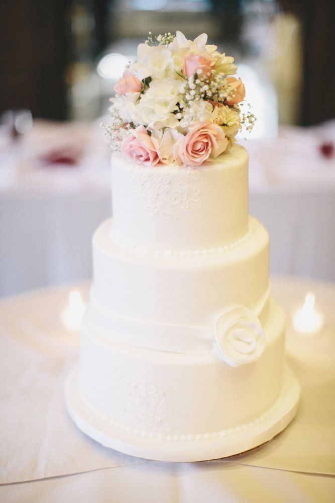 Simple White Wedding Cake With Flower Bouquet Topper | photography by http://heatherjowett.com/