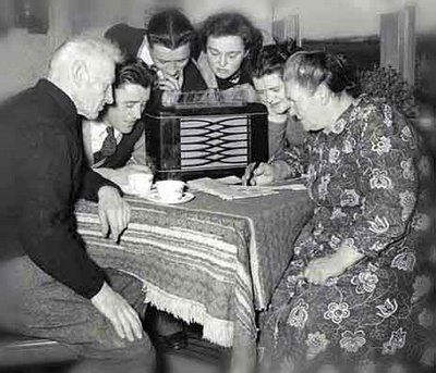 Listening to the Radio was a family, or (given the cost of radios) even a community, activity. Description from alternatehistory.com. I searched for this on bing.com/images