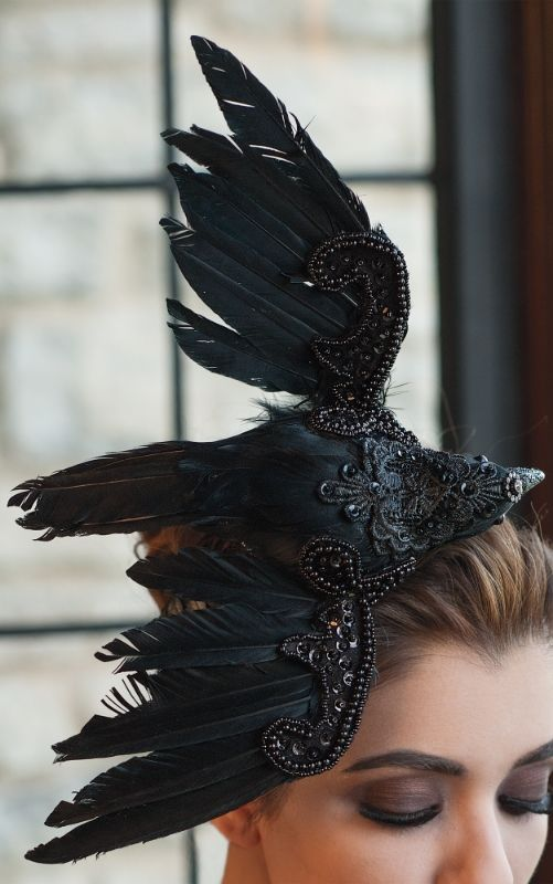 Just slip on our handmade Gothic Raven Headband, and crown yourself queen of the Halloween ball. It's the simple, yet sophisticated, alternative to the costume. The life-size raven is artfully embellished with a melange of natural feathers, sequins, and intricate embroidery.