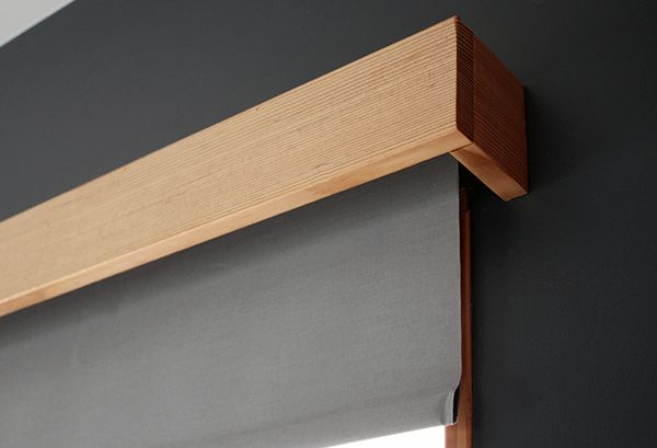 Simple wood valance for roller shade. Genius.