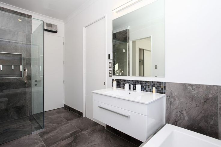 Modern bathroom, wall hung vanity, tiled show, grey tiles
