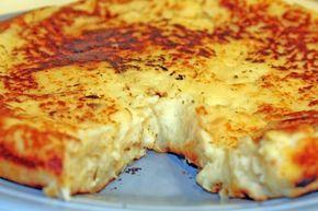 Μάθετε πώς μπορείτε να φτιάξετε νόστιμη παραδοσιακή Πατατόπιτα απο την Τήνο γρήγορα και εύκολα. Υλικά 2½ κιλά πατάτες 100 ml ελαιόλαδο λίγο επιπλέον για το ταψί 1 κρεμμύδι μεγάλο, κομμένο σε ψιλά καρέ 4 αυγά, ελαφρώς χτυπημένα 200 γρ. γραβιέρα Τήνου, τριμμένη, ή άλλο κίτρινο τυρί