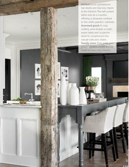 Rustic modern kitchen. grey + white + linen. Love the idea to extend kitchen counter to make a breakfast bar by adding a table pushed up to the counter.  And those bar stools actually look comfortable.