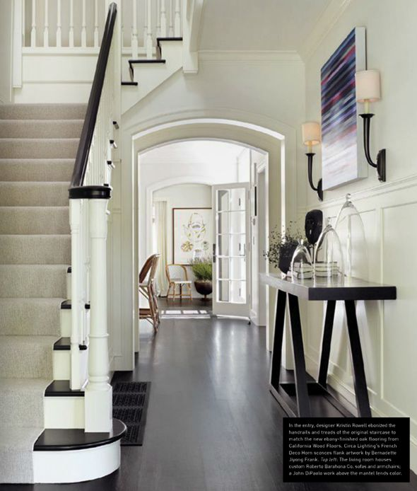 The entryway introduces the palette of crisp white millwork and espresso hardwoods. The architecture of this home is so graceful. The simplicity of the decor actually makes a very bold statement.