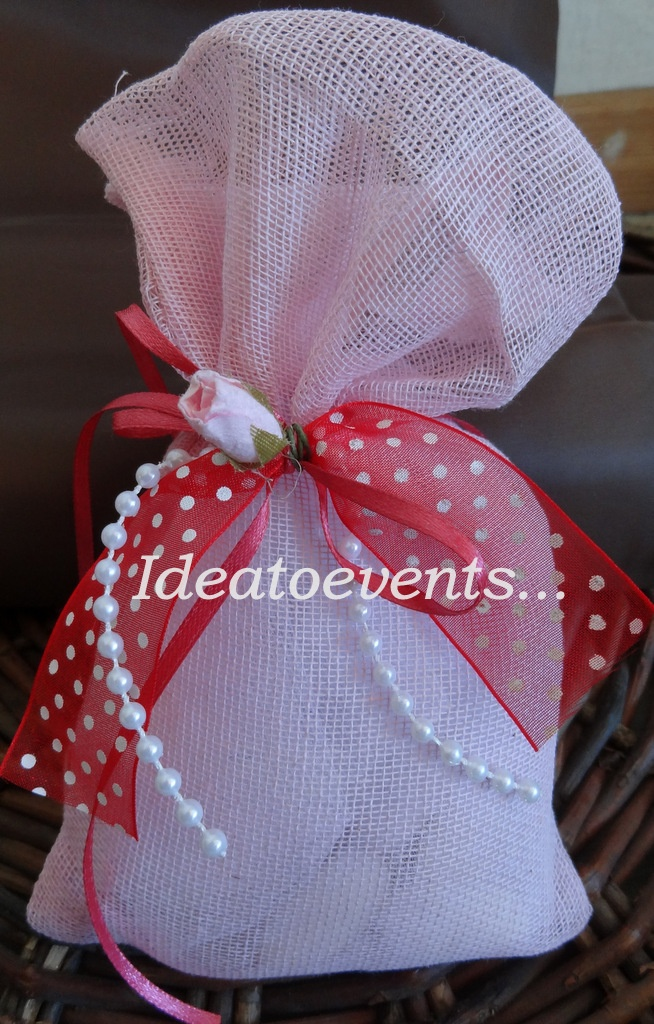 Romantic Wedding - Christening favor in a pink pouch combined with colorful ribbons and a nice little rose...  Ρομαντική μπομπονιέρα Γάμου - Βάπτισης συνδυασμένη με χρωματιστές κορδέλες και ροζέ τριανταφυλλάκι...