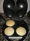 An arepa (Spanish pronunciation:[aˈɾepa]) is a dish made of ground corn dough or cooked flour, very prominent in the cuisine of Colombia and Venezuela.[1] It is similar in shape to the Mexican gordita and the Salvadoran pupusa. Arepas can also be found in Panama, Puerto Rico, the Dominican Republic, and the Canary Islands.