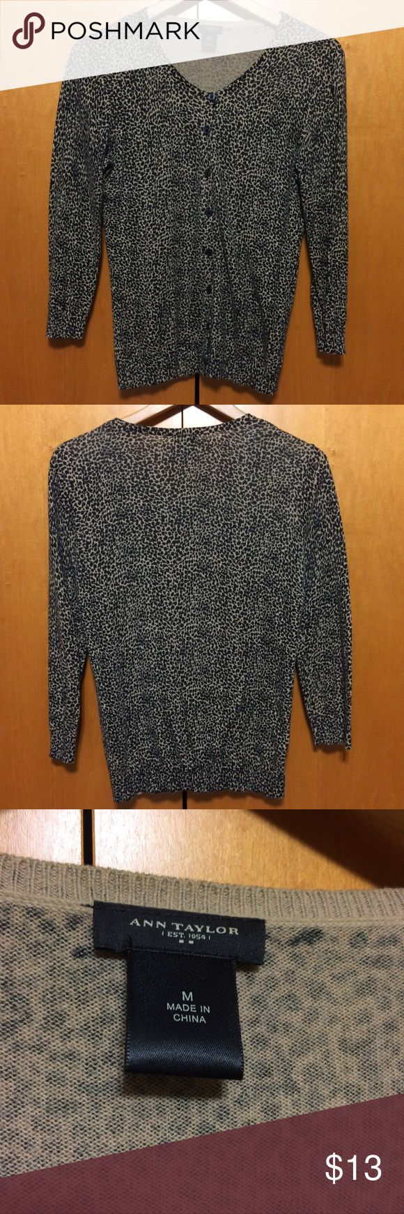 Ann Taylor Animal Print Cardigan Cute fitted cardigan with 3/4 sleeves. Lightweight. Cheetah/leopard print. Round neck. Buttons up the front. No flaws. Ann Taylor Tops