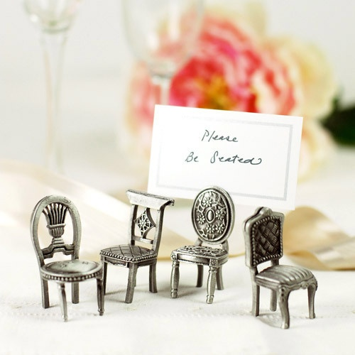 Antique victorian chairs as place card holders for a vintage wedding!