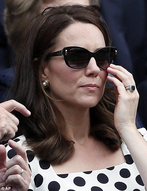 Kate watches the action in the Royal Box on the opening day at the Wimbledon Tennis Champi...