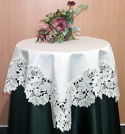 Serena is a German import available as a 37X37 Lace Table Topper at $152.95.