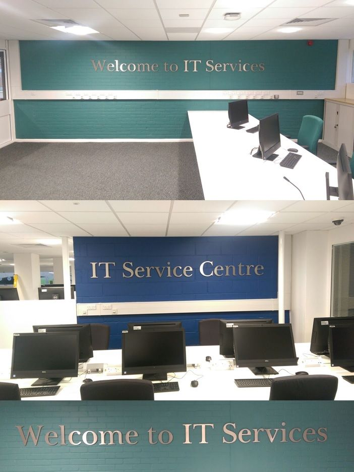 Fret cut brushed stainless steel letters on stand off locators manufactured by The Sussex Sign Company