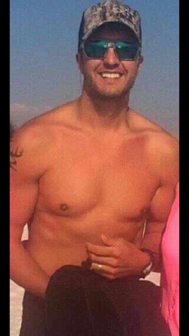 Luke Bryan shirt less man nothing better looking than that!