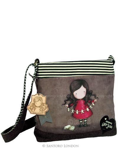 """Deze tas het merk GORJUSS is afgewerkt met roodbruine tweed, en heeft het thema: """"I Found my Family in a Book"""" afgebeeld op de voorkant. De riem is ook in een prachtige tweed met karakteristieke Gorjuss zwart en crème strepen op de achterzijde."""