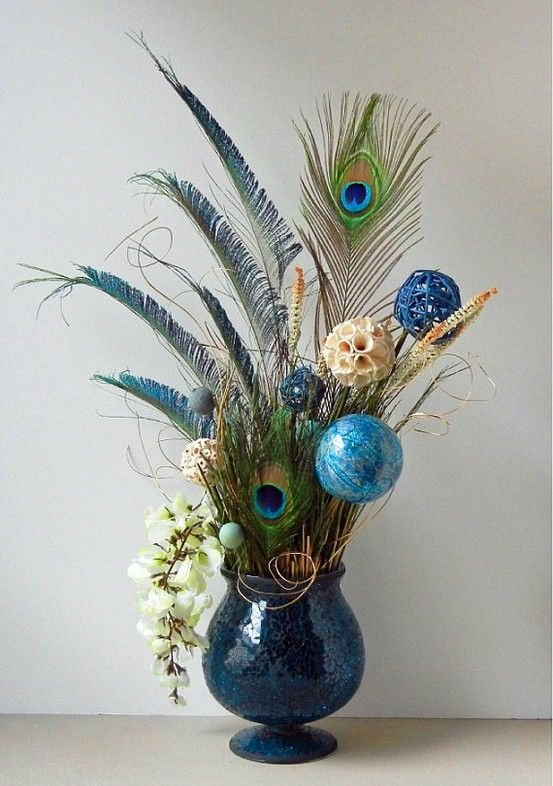 Floral arrangements peacock arrangement with blue