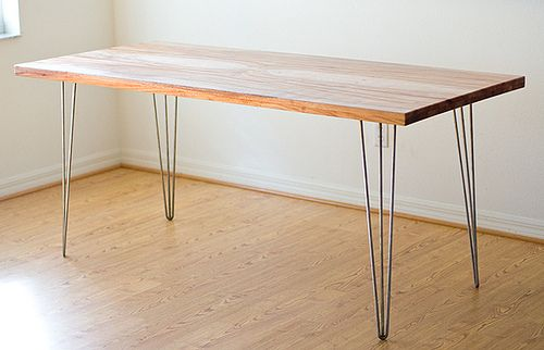 Plank + hairpin legs = awesome desk for about $100.    Buy legs here: http://hairpinlegs.com/products.php?id=1